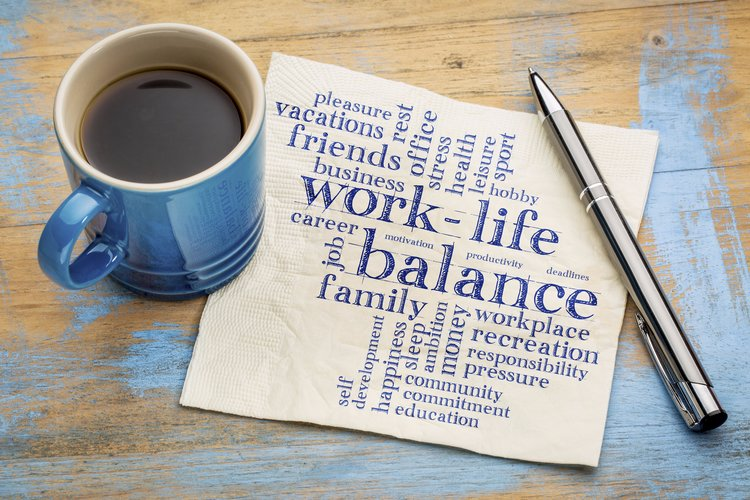 image of coffee mug with a napkin that says a few words related to work-life balance