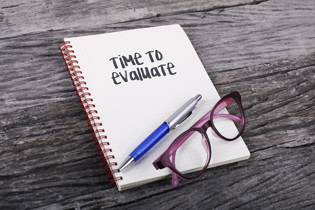 """image of notepad that says """"Time to Evaluate"""""""
